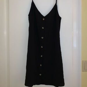 Cute black dress that buttons up in the front!